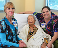 Patient with two caring nurses at Cancer Center